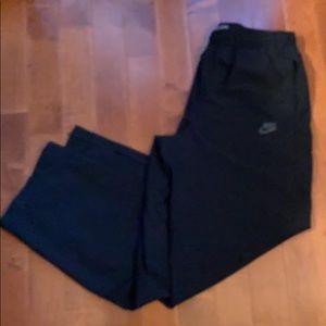 Nike athletic track pants. Zipper cuffs
